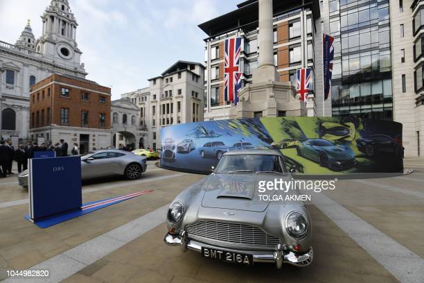 Models of cars by luxury British sports car manufacturer Aston Martin are parked outside the London Stock Exchange on October 3 2018 in London as the...