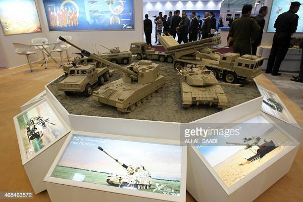 Models of Chinesemade military vehicles from the China North Industries Corporation are displayed during the fourth session of the Baghdad...