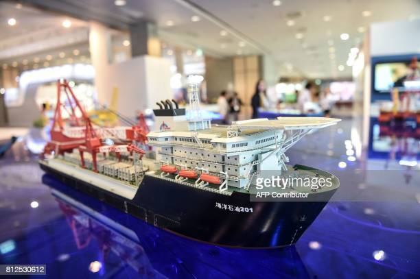 Models of oilwell station and oil researching ships are displayed at stands on July 11 2017 during 22nd World Petroleum Congress in Istanbul Oil...