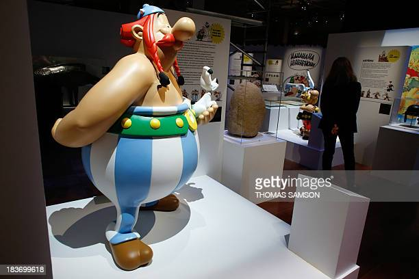 Models of the characters of Obelix and dog Idefix and Asterix are displayed at the Bibliotheque nationale de France on October 9 in Paris prior to...