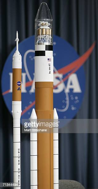 Models of the new crew exploration vehicles Ares 1 and Ares 5 are seen on display during the Exploration Update news conference at the Kennedy Space...