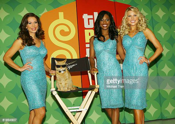 Models of The Price is Right Brandi Sherwood Lanisha Cole and Rachel Reynolds pose with 9Lives icon Morris the Cat to kickoff a video contest that...