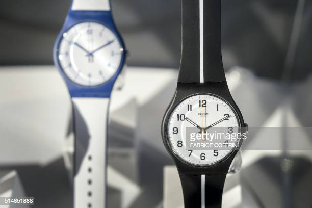 Models of the Swatch brand Swiss watches are pictured within a press conference to present the fullyear results of the worlds number one watchmaker...