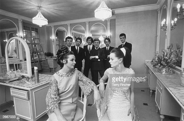 Models Olga Yates and Wendy Hamilton with a group of assistants at the opening of the royal couturier Sir Norman Hartnell's hairdressing salon