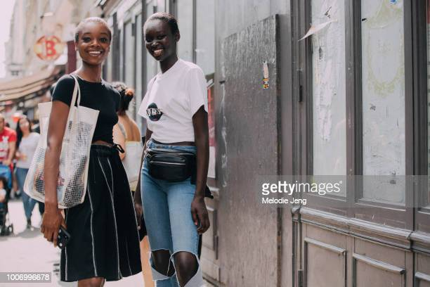 Models Olivia Anakwe Subah Koj after Viktor Rolf during Couture Fall/Winter 2018 Fashion Week on July 4 2018 in Paris France Olivia wears ablack top...
