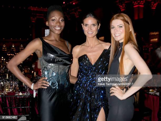 Models Oluwatoniloba DreherAdenuga Heidi Klum and Klaudia Anna Giez attend the 2018 amfAR Gala New York at Cipriani Wall Street on February 7 2018 in...