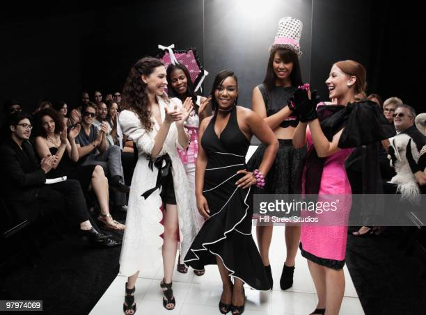 models on runway in fashion show - catwalk stock photos and pictures