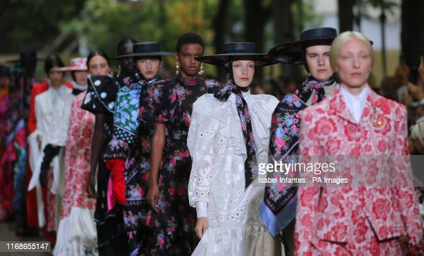 Models on the catwalk at the Erdem Spring/Summer 2020 London Fashion Week at Grays Inn Gardens, London.