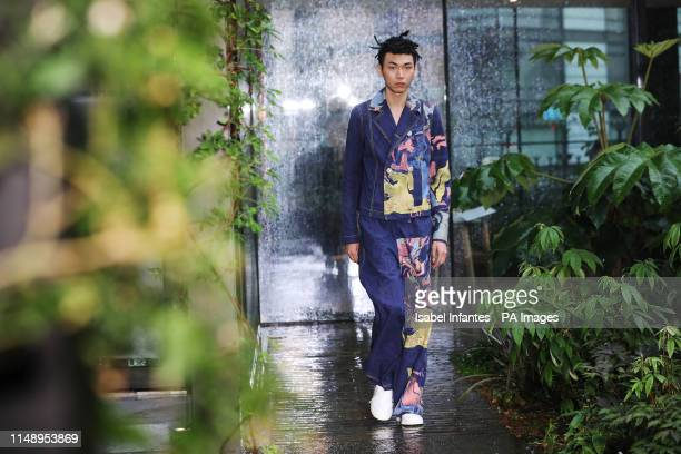 Models on the catwalk during the Bethany Williams London Fashion Week Men's SS20 show at the Garden Museum London PRESS ASSOCIATION Picture date...