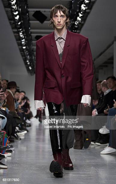Models on the catwalk during the JOHN LAWRENCE SULLIVAN London Fashion Week Men's AW17 show held at BFC Show Space, London.
