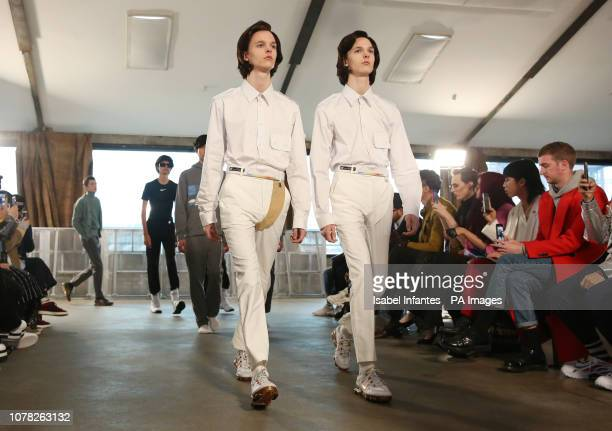 Models on the catwalk during the Xander Zhou at London Fashion Week Men's AW19 show held at The Oval Space London