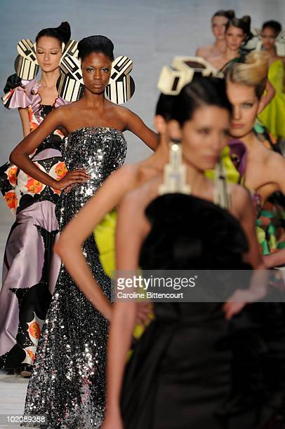 Models on the catwalk in the end of Andre Lima's fashion show during the sixth day of the Sao Paulo Fashion Week Summer 2011 at the Ibirapuera's...