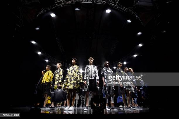 Models on the runway at the end of the MCM x Christopher Raeburn SS17 show at Grand Connaught Rooms on June 11 2016 in London England