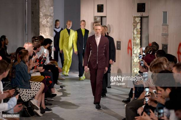 Models on the runway at the Kiko Kostadinov Presentation during the London Fashion Week Men's June 2017 collections on June 11 2017 in London England