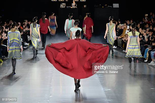 Models on the runway during the Issey Miyake show finale as part of the Paris Fashion Week Womenswear Fall/Winter 2016/2017 on March 4 2016 in Paris...