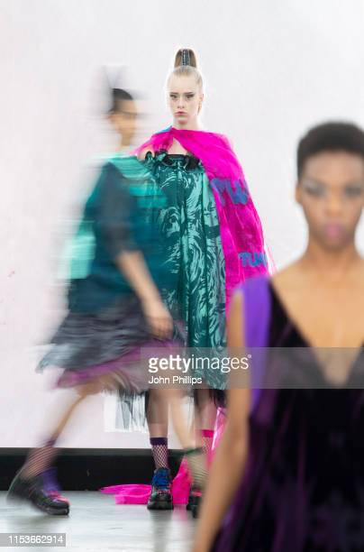 Models on the runway in designs by Amber Rawlins during the Northampton University show at Graduate Fashion Week at The Truman Brewery on June 04...