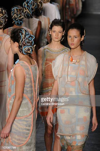 Models on the runway in the end of Fernanda Yamamoto's fashion show during the sixth day of the Sao Paulo Fashion Week Summer 2011 at Bienal pavilion...