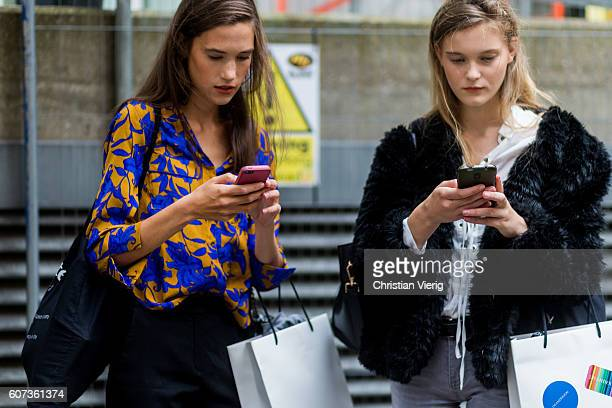 Models on their phone outside of JW Anderson during London Fashion Week Spring/Summer collections 2017 on September 17 2016 in London United Kingdom