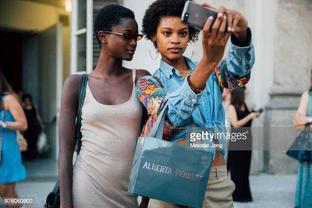 Models Oumie Jammeh Theresa Hayes take a selfie outside the Alberta Ferretti Resort 2019 show during Milan Men's Fashion Week Spring/Summer 2019 on...