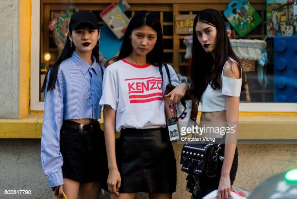 Models outside Kenzo during Paris Fashion Week Menswear Spring/Summer 2018 Day Five on June 25 2017 in Paris France