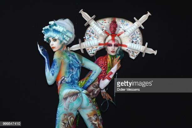 Models painted by bodypainting artist Alex Hansen from Brasil and Benoit Botella from Guadaloupe pose for a picture at the 21st World Bodypainting...