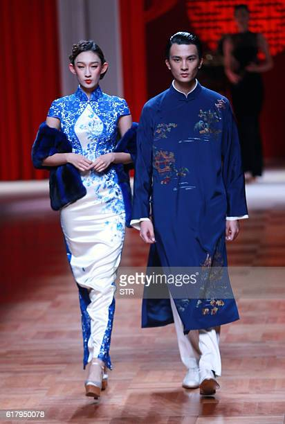 Models parade creations from NETIGER Collection designed by Tiger Zhang at China Fashion Week in Beijing on October 25 2016 / AFP / STR / CHINA OUT