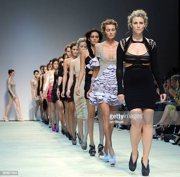 Models parade down the catwalk during the Mark Fast fashion show at the Topshop Venue, University of Westminster, on September 19, 2009 in London,...