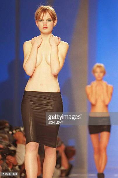 Models parade down the runway wearing black stretch skirts at the beginning of the DKNY Spring 1996 fashion show 29 October in New York. Fashion week...