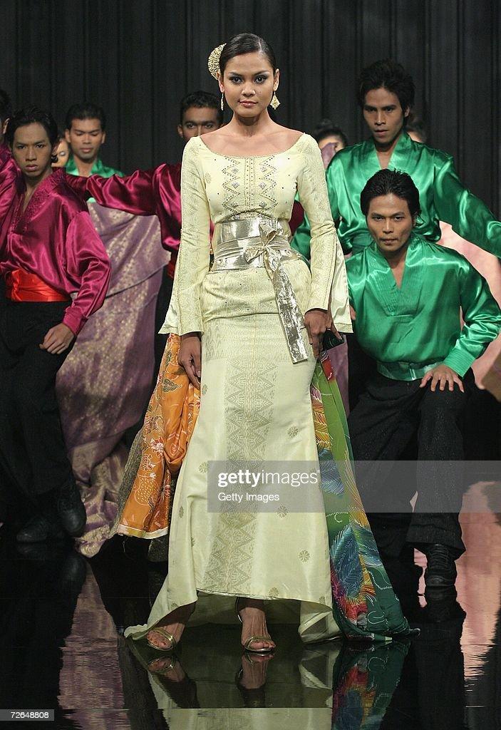 Models parade during the show by designer Roziah from Kraftangan in 'A tribute to Malaysian Craft' on the third day of Malaysian-International Fashion Week at the Kuala Lumpur Convention Centre on November 25, 2006 in Kuala Lumpur, Malaysia.