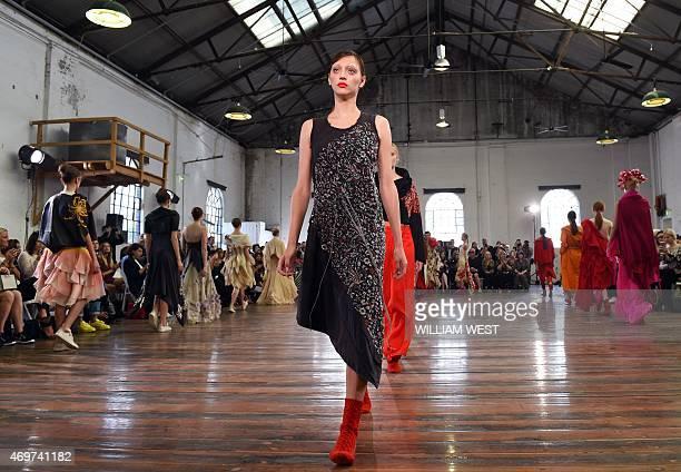 Models parade garments by Australian designer Akira Isogawa during Fashion Week Australia in Sydney on April 15 2015 AFP PHOTO / William WEST
