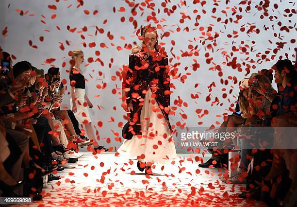 Models parade garments by Australian designer Jayson Brunsdon during a parade at Fashion Week Australia in Sydney on April 14 2015 AFP PHOTO /...