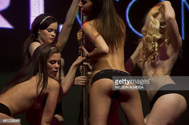 Models perform a striptease show during the Erotika Fair in Sao Paulo Brazil on March 28 2014 The event the biggest of its kind in Latin America...