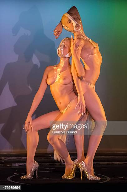 Models perform on stage during the Charlie Le Mindu show as part of Paris Fashion Week Haute Couture Fall/Winter 2015/2016 on July 8 2015 in Paris...