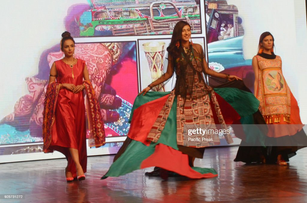 Models perform on stage wearing traditional outfits during the China Ancient Show of CPEC Cultural Caravan Festival in Lahore