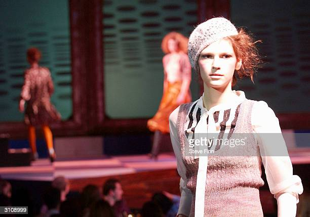 """Models perform on the catwalk at the """"TopShop Unique"""" 'fashion extravaganza' fashion show to preview autumn/winter 2004 collections at York Hall on..."""