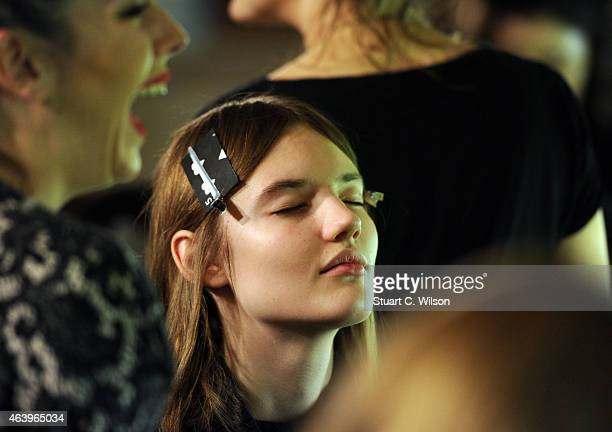 Models perpare backstage at the Fyodor Golan show during London Fashion Week Fall/Winter 2015/16 at Royal College of Surgeons on February 20 2015 in...