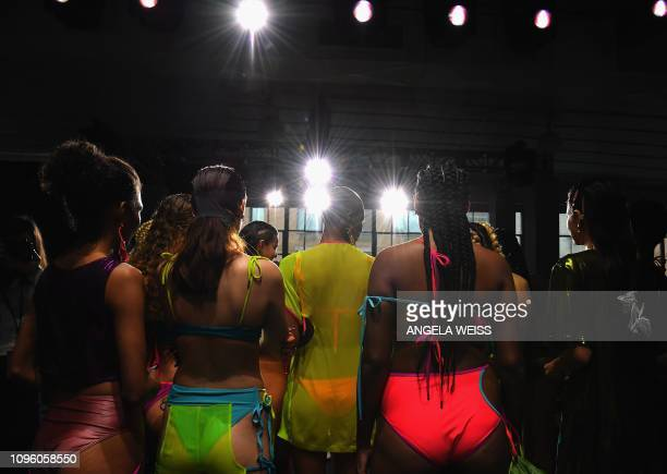 Models perpare backstage for the Chromat fashion show during New York Fashion Week The Shows at Industria Studios on February 8 2019 in New York City