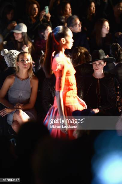 Models Petra Nemcova and Coco Rocha attends the Herve Leger By Max Azria fashion show during Mercedes-Benz Fashion Week Fall 2014 at The Theatre at...