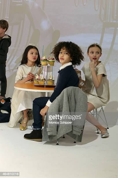 Models play on the runway at the Anais I show during petitePARADE / Kids Fashion Week at Bathhouse Studios on February 28 2015 in New York City