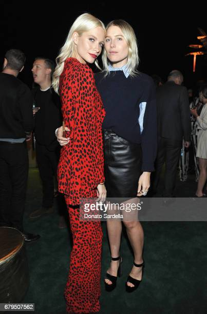 Models Poppy Delevingne and Dree Hemingway attend the Panthere de Cartier Party in LA at Milk Studios on May 5 2017 in Los Angeles California