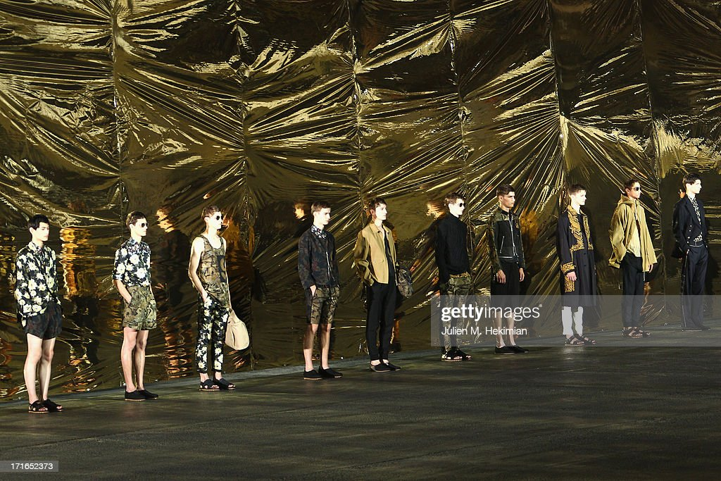 Models pose after the Dries Van Noten Menswear Spring/Summer 2014 show as part of the Paris Fashion Week on June 27, 2013 in Paris, France.