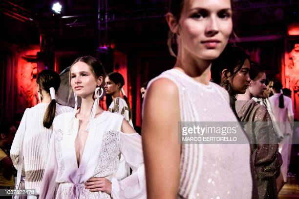 Models pose after the Les Copains fashion show as part of the Women's Spring/Summer 2019 fashion week in Milan on September 22 2018