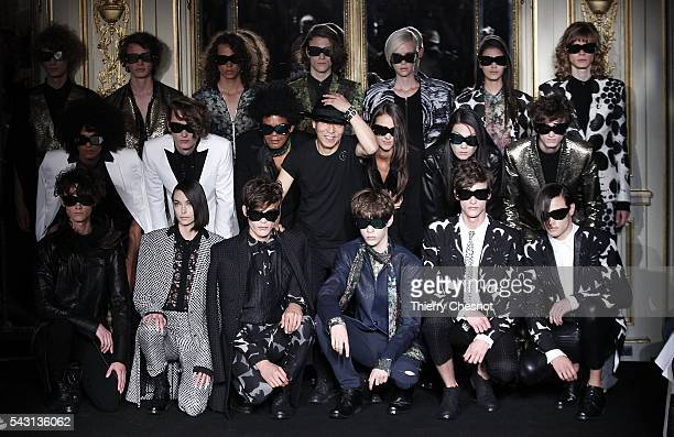 Models pose after the Rynshu Menswear Spring/Summer 2017 show as part of Paris Fashion Week on June 26, 2016 in Paris, France.