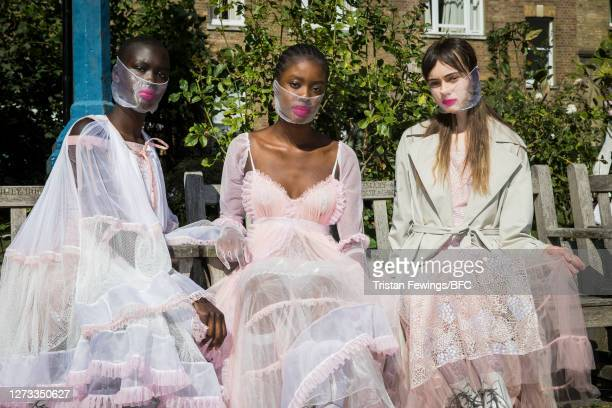 Models pose ahead of the Bora Aksu show during LFW September 2020 at St Paul's Church on September 18, 2020 in London, England.