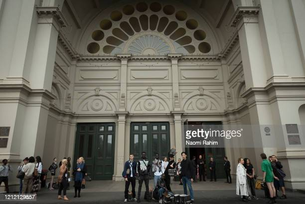 Models pose and crew leave the Royal Exhibition Building on March 13 2020 in Melbourne Australia Melbourne Fashion Festival organisers announced on...