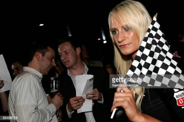 Models pose as they participate in the catwalk show for the Gridmodels 2006 Calendar Catwalk Competition at The Penthouse on August 24 2005 in London...