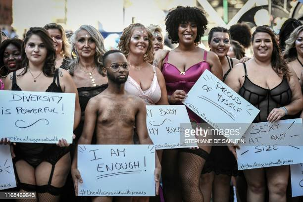TOPSHOT Models pose as they present creations during The All Sizes Catwalk event in Paris on September 15 2019 About 100 women of different body...