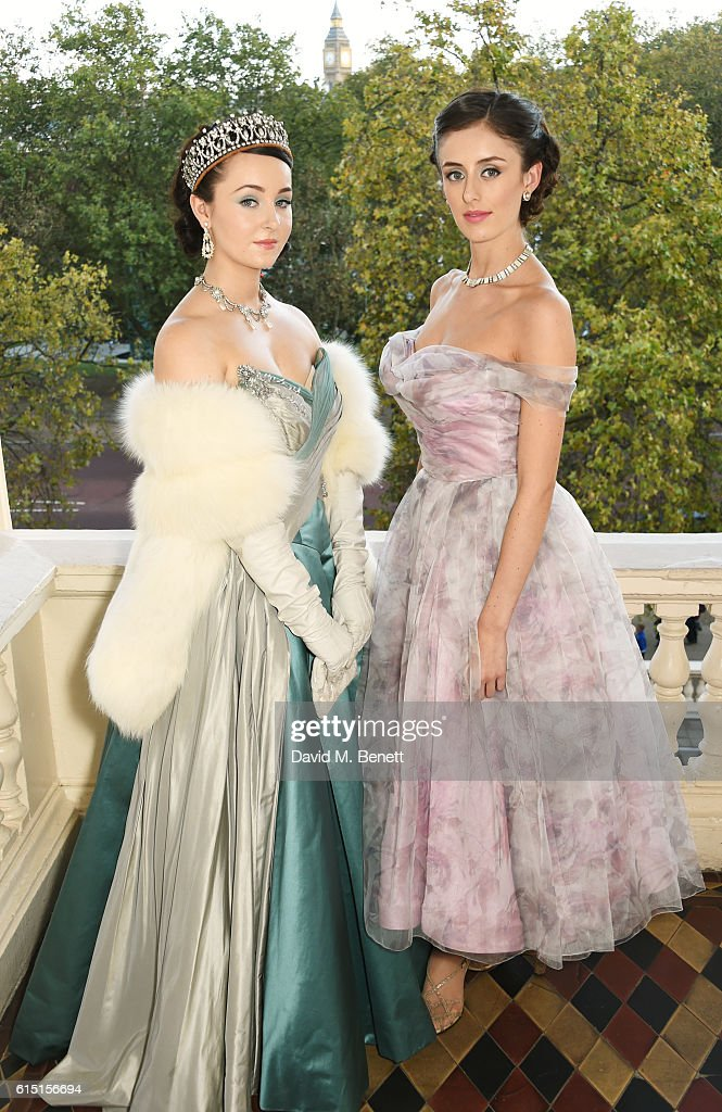 Models pose at a presentation featuring costumes from new Netflix Original series 'The Crown' with designer Michele Clapton at the ICA on October 17, 2016 in London, England.