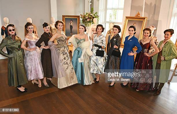 Models pose at a presentation featuring costumes from new Netflix Original series The Crown with designer Michele Clapton at the ICA on October 17...