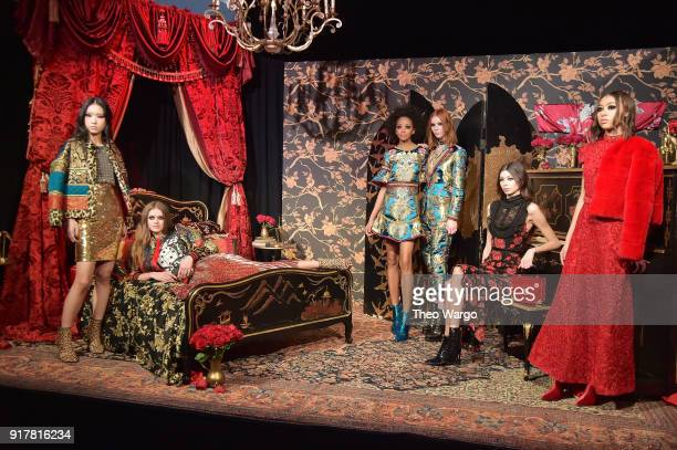 Models pose at Alice Olivia by Stacey Bendet during New York Fashion Week The Shows at Industria Studios on February 13 2018 in New York City